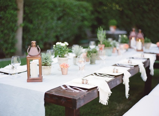Dark wood table with white linen runner