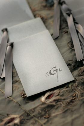 Metallic ceremony wedding programs with grey monogram and slate gray ribbon