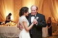 Bride in an Jenny Packham dress with lacy sleeves, back dances with father in black tuxedo