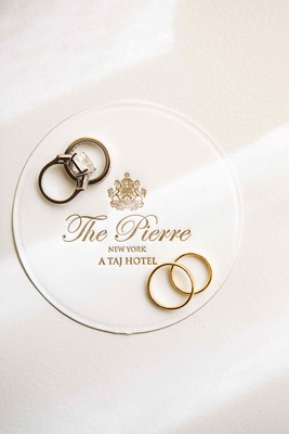 Bride and groom's wedding rings on The Pierre hotel coaster
