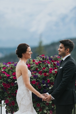 groom in Ermenegildo Zegna, bride in Watters, Banff National Park, gladiolus