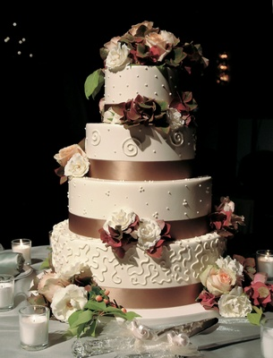 Four layer fall wedding cake with fresh rose and hydrangea decorations