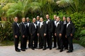 Groom with ten groomsmen in tuxedos in California