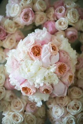 bridal bouquet with white and blush peonies and peach garden roses