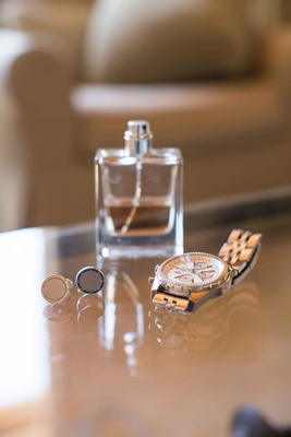 Silver cuff links and fancy watch and cologne