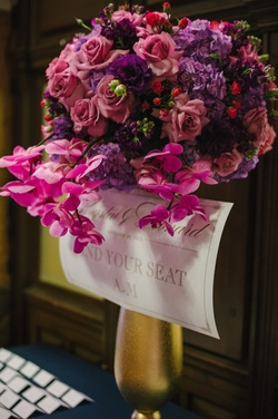 Gold vase with pink orchids, purple hydrangea, and roses