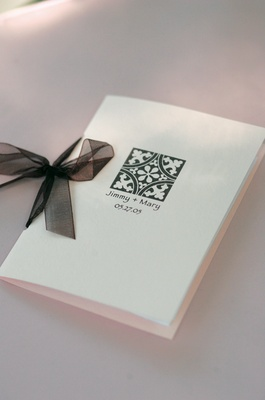 Wedding booklet with sheer ribbon tie