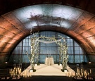 Jewish wedding at unique architectural venue in new york city underground looking greenery