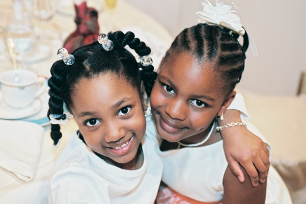 African-American flower girl and her friend