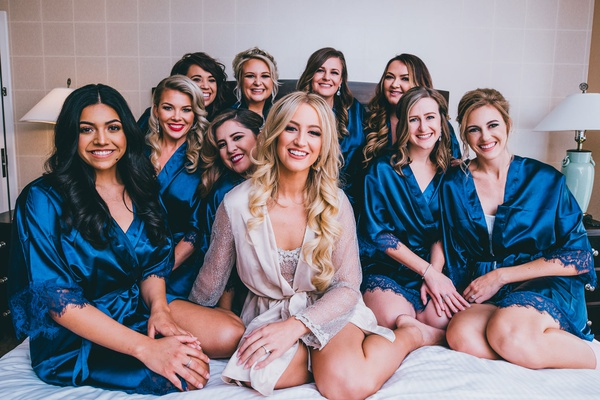 bride in sheer robe and bridesmaids in navy blue robes with lace trim