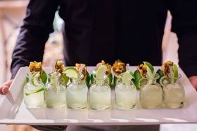 White tray with margaritas topped with limes and lime taco holders appetizer wedding