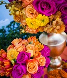 Orange rose, fuchsia rose, red and yellow tulip, yellow chrysanthemum, yellow orchid wedding flowers