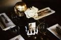 wedding reception skeleton hand holding beware sign gold skull white flowers