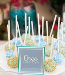 gourmet oreo cake pops in blue, green, with sprinkles for dessert bar
