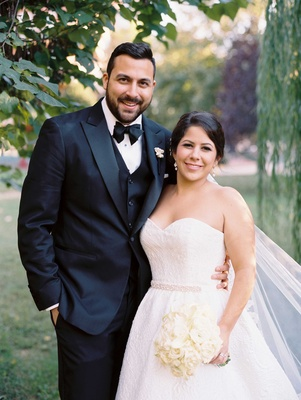 Gabriela Velez and Vincent Cuellar wedding portraits groom in tuxedo and strapless wedding dress