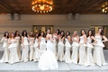 Bridesmaids in strapless peplum gowns with bride