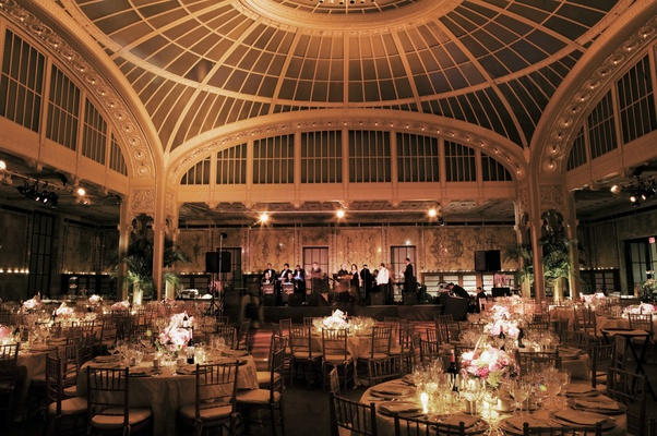 Domed ceiling with round tables and stage