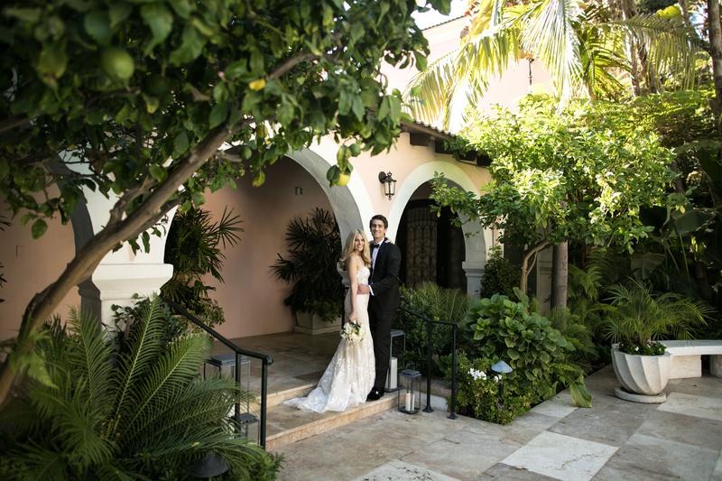 wedding portrait bride in inbal dror groom at hotel bel-air wedding venue in los angeles california