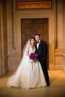 Wedding couple Kristina Bocci and Driton Tomaj wedding portrait ball gown tuxedo bow tie