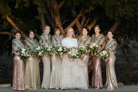 bride in martina liana layered ballgown, bridesmaids in mismatched metallic sequin dresses and furs