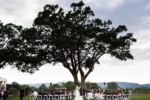 Wedding ceremony under oak tree at the Sleepy Hollow Country Club