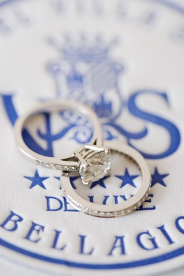Wedding ring and engagement ring on blue hotel logo