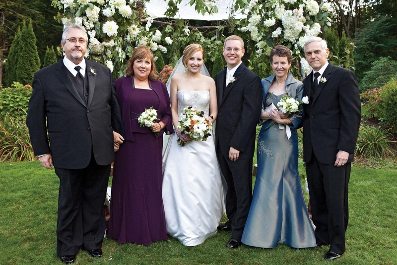Bride and groom with both sets of formal parents