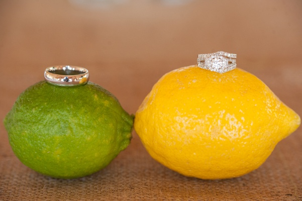 Wedding ring on lime and engagement ring on lemon