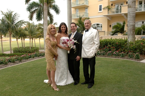 Bride and groom with father and mother of bride