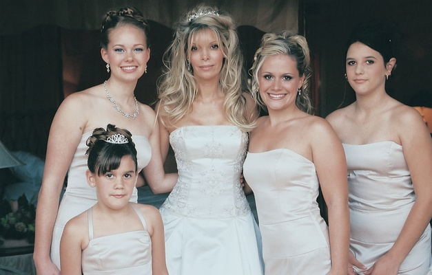 bride poses with four ladies in her family