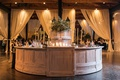 light wooden circular bar with display of greenery