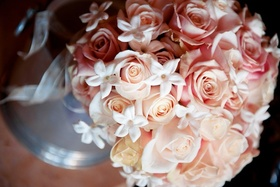 Pink and peach rose bouquet with white stephanotis