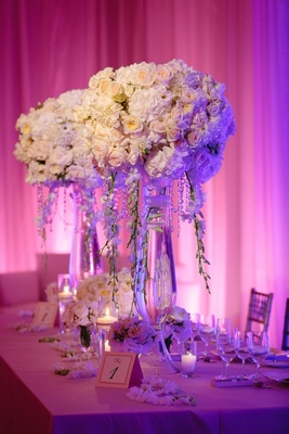 purple pink uplighting, centerpieces with roses, hydrangeas, mums, and chrysanthemums