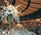 Silver chairs and glass vases filled with white flowers