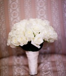Still life image of ivory rose wedding bouquet