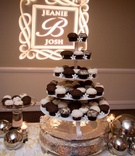 Sprinkles cupcakes and stephanotis on cake stand