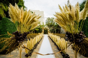 outdoor wedding at vibiana, pampas grass at start of aisle