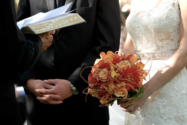 Bride's bouquet of orange and yellow flowers