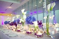 Long wedding table with blue hydrangea and purple flowers