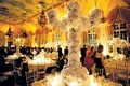 Wedding centerpiece with white flowers over tall candelholder