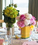 Pink peony flowers in pencil centerpiece and green flowers in ruler centerpiece place cards school