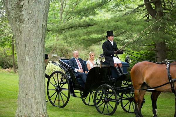 Bride with father of the bride in horse drawn carriage top hat unique transportation grand entrance
