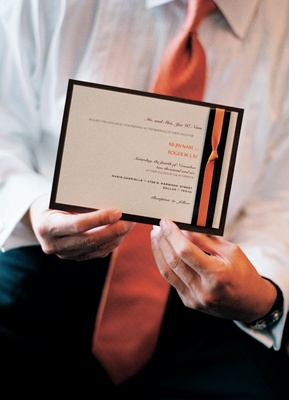 Wedding invitation with brown and orange ribbon