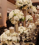 glitzy gold centerpieces, wedding king's table with varying heights