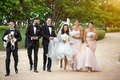 bride in custom rivini high-low wedding dress, groom in tux, bridesmaids in blush monique lhuillier