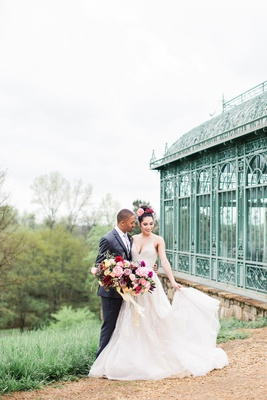 2400 on the river wedding inspiration, enclosed mint green gazebo, bride and groom with full bouquet