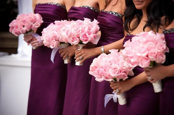 Purple bridesmaid dresses and rose nosegays