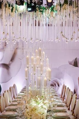 wedding reception large flower print wallpaper modern candelabra white roses crystals ribbon hanging