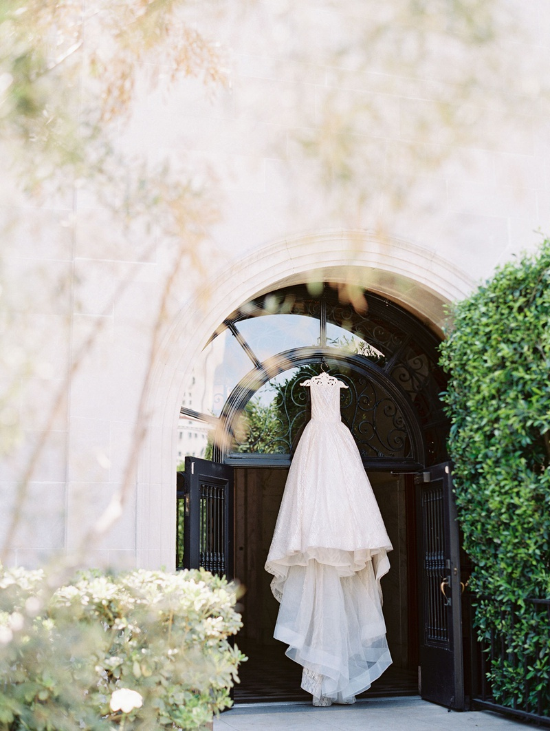 JLM Couture Lazaro wedding dress hanging from vibiana wedding venue downtown los angeles cathedral