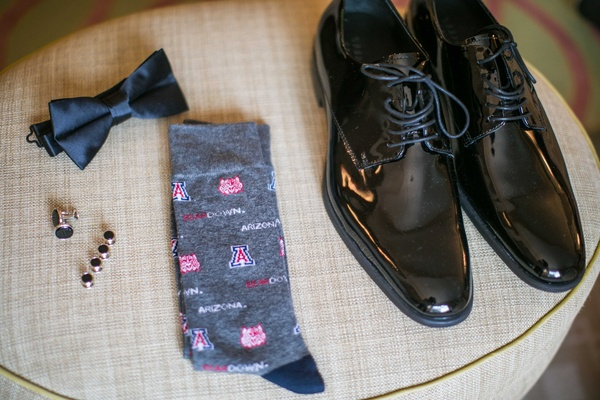 Groom's dress shoes, cuff links, bow tie, and U of A socks